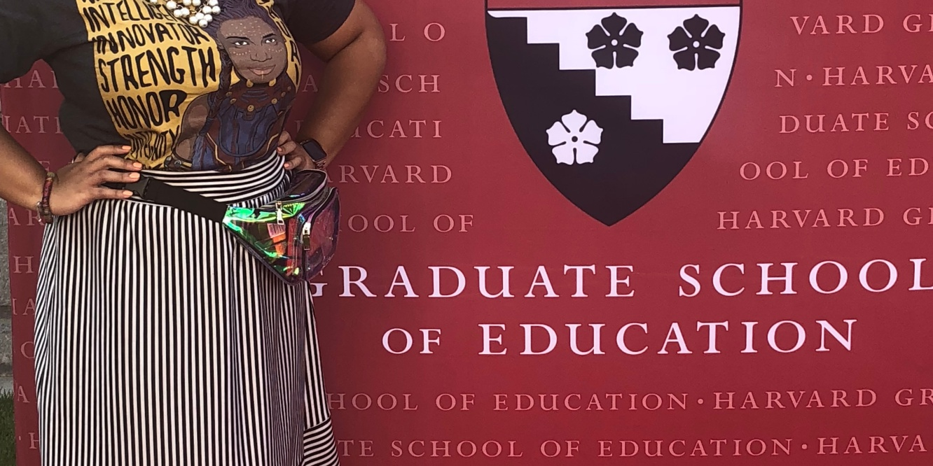 Author Erica Jordan-Thomas in front of an HGSE back drop